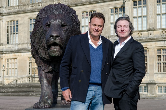 Sculptor Bruce Little, left, with Ceawlin Thynn and the new lion sculpture PIC David McGirr