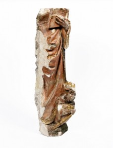Sculpture of St Catherine, late 15th century.Following the dissolution of the monasteries this fragment was used as building stone. It was recovered from a wall in Master's Court in the 1940s