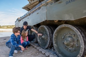 Alfie and Millie Hands with a member of the Royal Tank Regiment beside a Challenger 2 Main Battle Tank ahead of the Longleat Military Spectacular