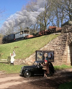 Back to the 1940s: the West Somerset Railway's military train, loaded with Army vehicles and under guard, steams past locals between Crowcombe and Stogumber. (Picture: Robin White)