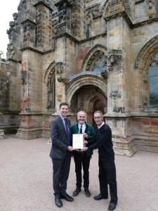 Neil Hamilton (middle) and Billy Forrester (right) at Rosslyn Chapel receives the Coach Friendly Visitor Attraction certificate from Jeremy Tinsley, General Manager CPT UK Scotland (left)