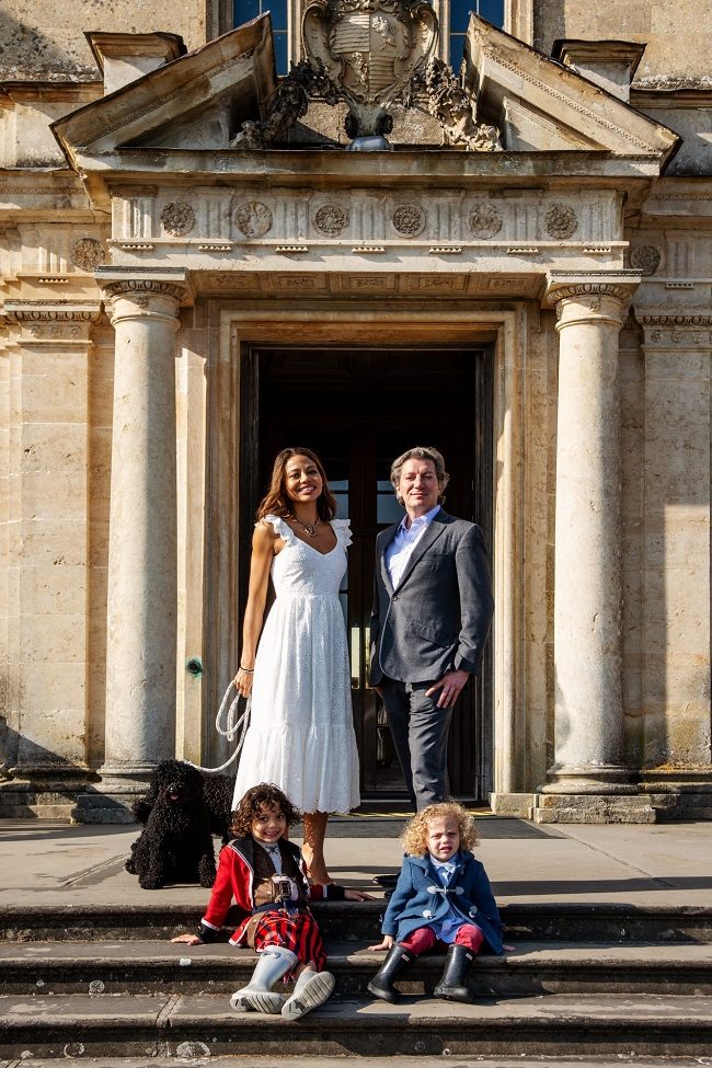 Viscount and Viscountess Weymouth with sons John and Henry plus dogs outside the front of Longleat House